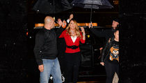 Mariah Carey -- I Don't Do Rain! Send in My Umbrella Team (PHOTOS)