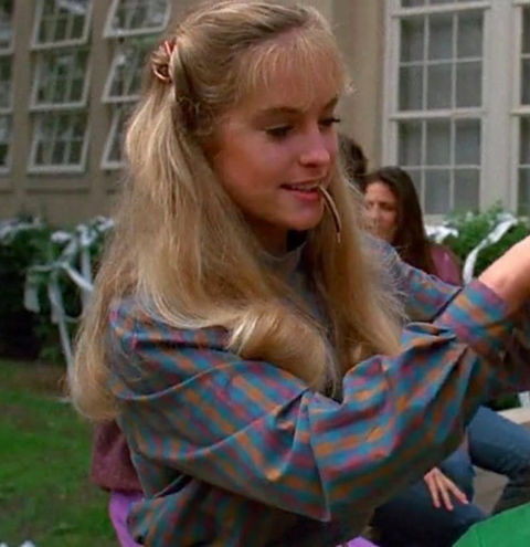 "Amanda Wyss as ""Lisa."""
