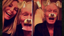 Hugh Hefner Proves He's Alive With Snapchat Dog Filter (VIDEO)