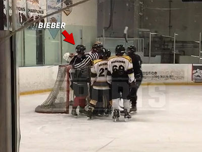 Justin Bieber Held Back From Fighting After Dirty Hockey Play (VIDEO)