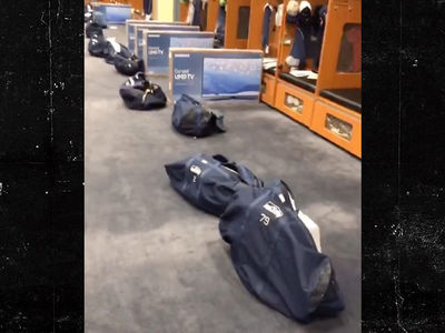 Russell Wilson Surprises Linemen ... TVs For Everyone!!! (VIDEO)