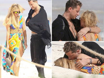 Paris Hilton Has a Roll in the Sand with New Dude (PHOTO GALLERY)