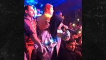 Justin Bieber Braves Bronchitis, Surprises Crowd with Mini Performance (VIDEO)