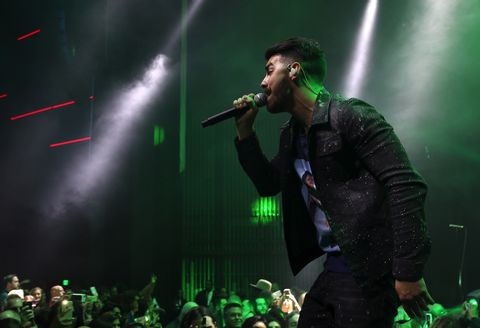 Joe Jonas performing at the Maxim Super Bowl Party