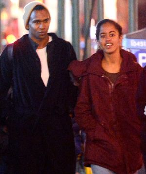 Malia Obama Strolling with Tall, Dark & Handsome Mystery Guy