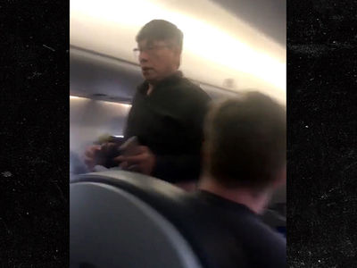 United Airlines Bloodied Passenger Bolted Back Onto Plane (VIDEOS)