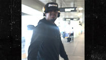 Marshawn Lynch Smacks Phone from Fan at LAX, Spits (VIDEO)