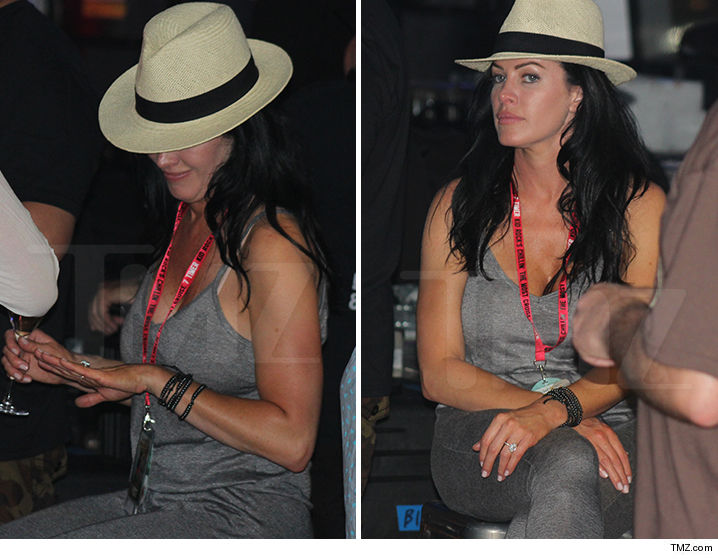 Kid Rock's fiance Audrey Berry showing off and eyeing her diamond ring
