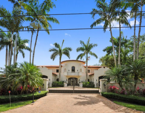 <span>The 6 bedroom, 7.5 bathroom compound sits inside an exclusive gated community, and it has all the bells and whistles -- from a grand foyer entrance and media room to a pool, spa, tennis court and, of course, a basketball court.</span>
