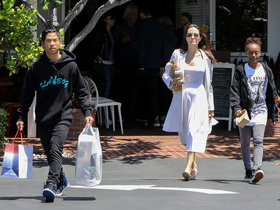 Angelina Jolie Takes Kids Shopping, Pax in Full 'Playboy' Mode (PHOTOS)
