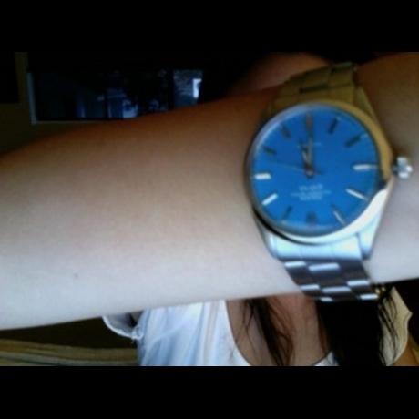 Rachel Lee wearing Rolex