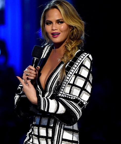 b06c04fd Dueling Dresses: Chrissy Teigen vs. Kim Kardashian   toofab.com