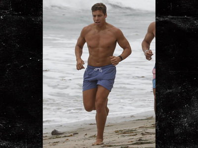 Arnold Schwarzenegger's Son, Joseph Baena, Goes on Shirtless Beach Jog with His Bros