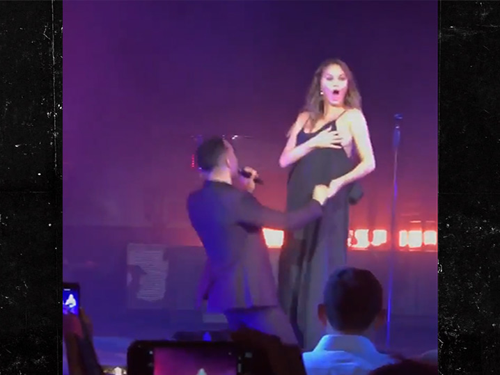 Chrissy Teigen bares a boob onstage at husband's NY gig