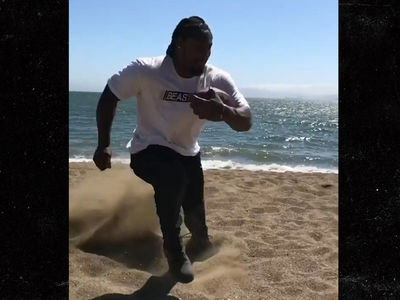Marshawn Lynch Intense Beach Training With Footwork Expert, Pounding Serious Sand