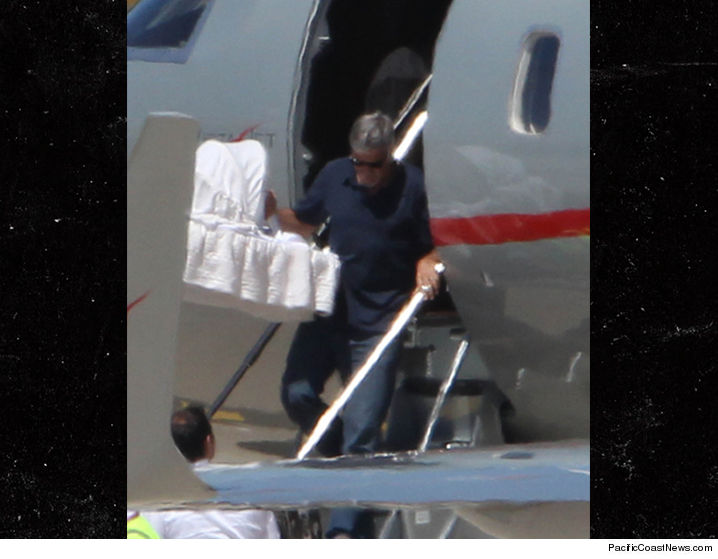 George Clooney takes newborn twins on vacation to Italy