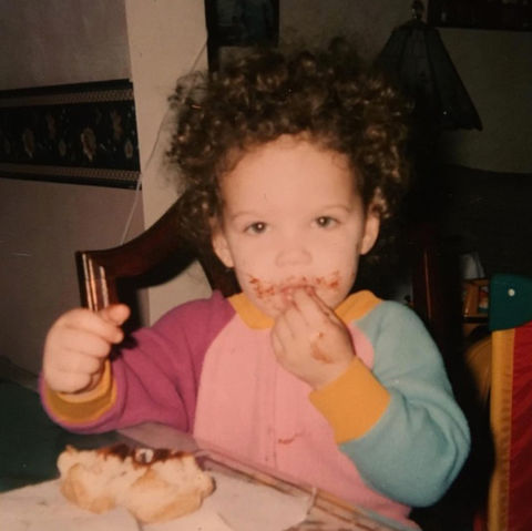 Before this curly-haired cutie was no stranger to Hollywood, she was just a messy munchkin with a sweet tooth in New Jersey.
