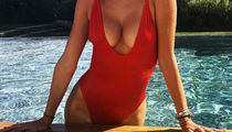 Guess Which Model Shared This Red Hot One-Piece Pic!