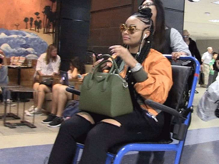 Blac Chyna Leaves LAX with Wheelchair Assist