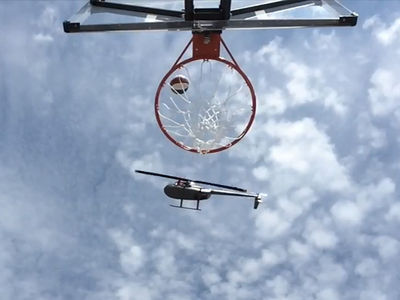 Globetrotters Hit Insane Trick Shot from Flying Helicopter!