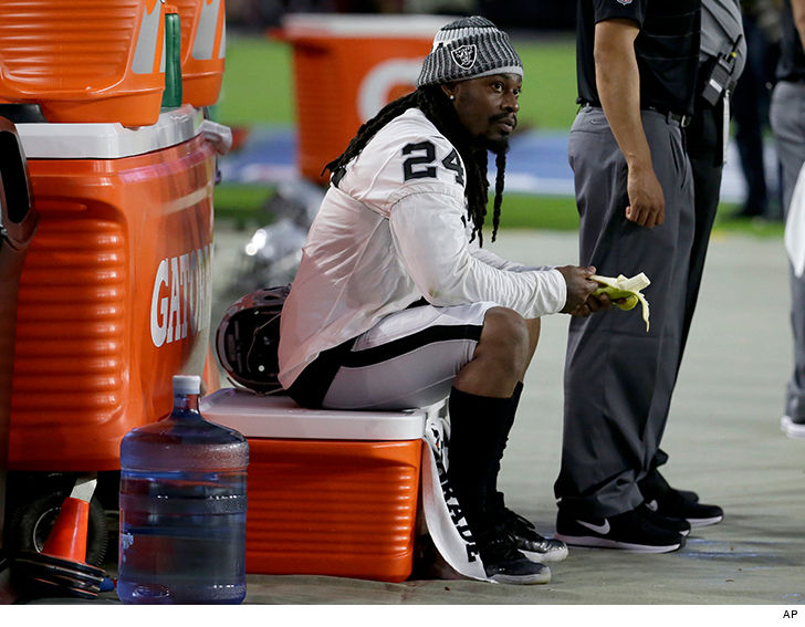 Marshawn Lynch sits during national anthem at Oakland Raiders preseason game