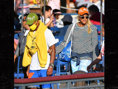 Pharrell Williams Fails to Mask Identity at Disneyland