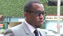 Diddy Settles with Photog for Alleged Beatdown on New Year's Eve 2011