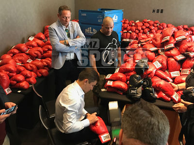 Gennady Golovkin Signs HUNDREDS of Boxing Gloves for Canelo Fight VIPs