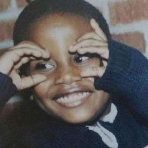Before this smiley little tot was topping the charts, he was just another cute kid spying with his little eyes growing up in Atlanta, Georgia.
