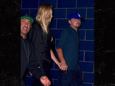 Leonardo DiCaprio Holds Hands with Ex Girlfriend Toni Garrn Leaving Club