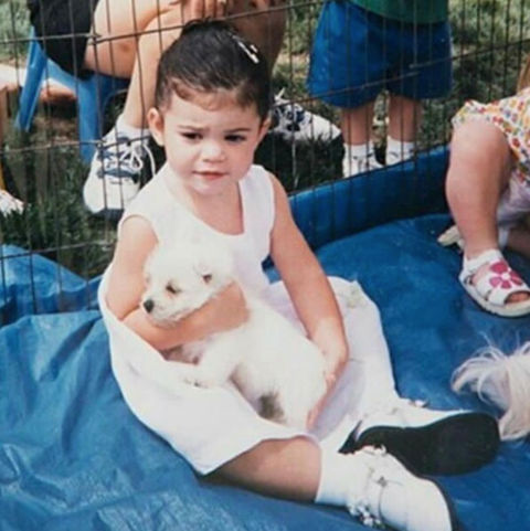 Before this ponytail princess was known for her iconic lips and big family, she was just another puppy-loving kid growing up in Calabasas, California.