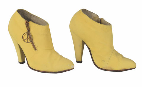 Prince's Personally-Owned and Stage-Worn Yellow Boots -- estimated price: $12,000