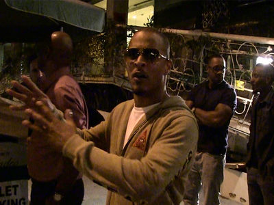 8-Year-Old Football Protesters Get Props from T.I.