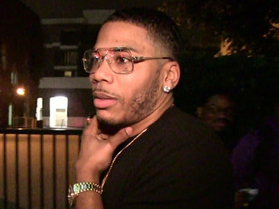 Nelly's Accuser Claims Rape Without Condom, His Lawyer Says He Has Proof She's a Liar