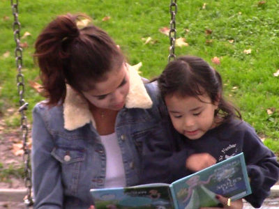 Selena Gomez Visits Park and Reads to a Little Girl