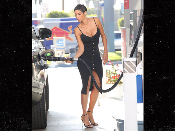 Nicole Murphy Pumps It Real Good at Beverly Hills Gas Station