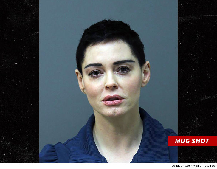 Rose McGowan surrenders to police over drugs arrest warrant