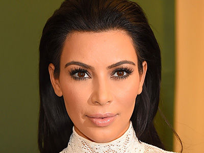 Kim Kardashian Is BUSTING OUT of One Her Most Stunning Looks Yet
