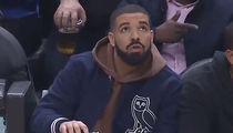 Drake Caught On Camera Pouring Drink at Raptors Game