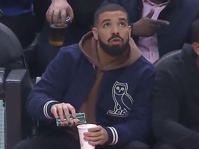Drake Caught On Camera Pouring Drink at Raptors Game