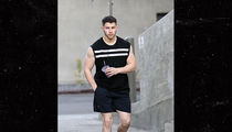 Nick Jonas Leaves Gym and Shows Off Guns