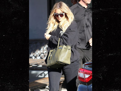 Khloe Kardashian Hides Baby Bump Behind Purse and Under Loose Sweater
