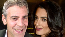 George and Amal Clooney Handed Out Noise-Canceling Headphones on Flight