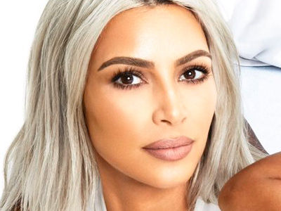 Kim, Kanye and Saint Take the Spotlight In Kardashian Holiday Card Pic
