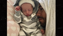Enrique Iglesias Posts First Pic of One of the Twins