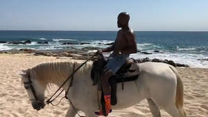 Floyd Mayweather Channels Inner-Putin for Topless Horse Ride