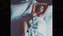 Kim Kardashian Topless in Bed, Still No Baby Name