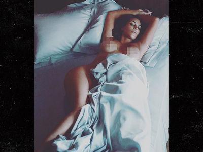 Kim Kardashian Topless in Bed, Still No Baby Name