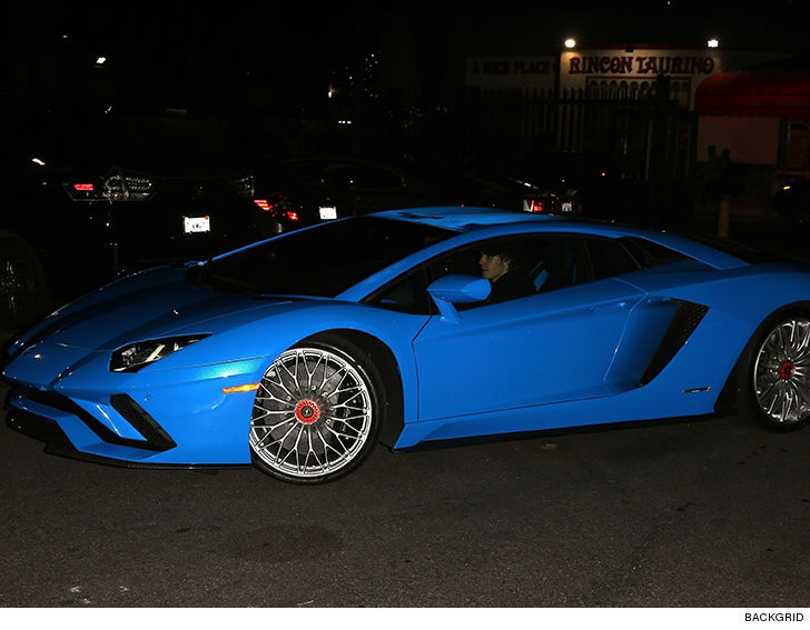 justin bieber leaves hockey game in baller lambo