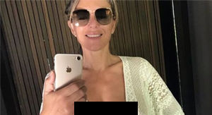 Elizabeth Hurley Decided To Ditch Her Bra With An Open Shirt In Steamy Bathroom Shot